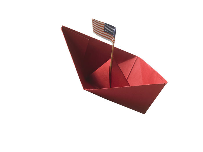 High angle view of paper flag against white background