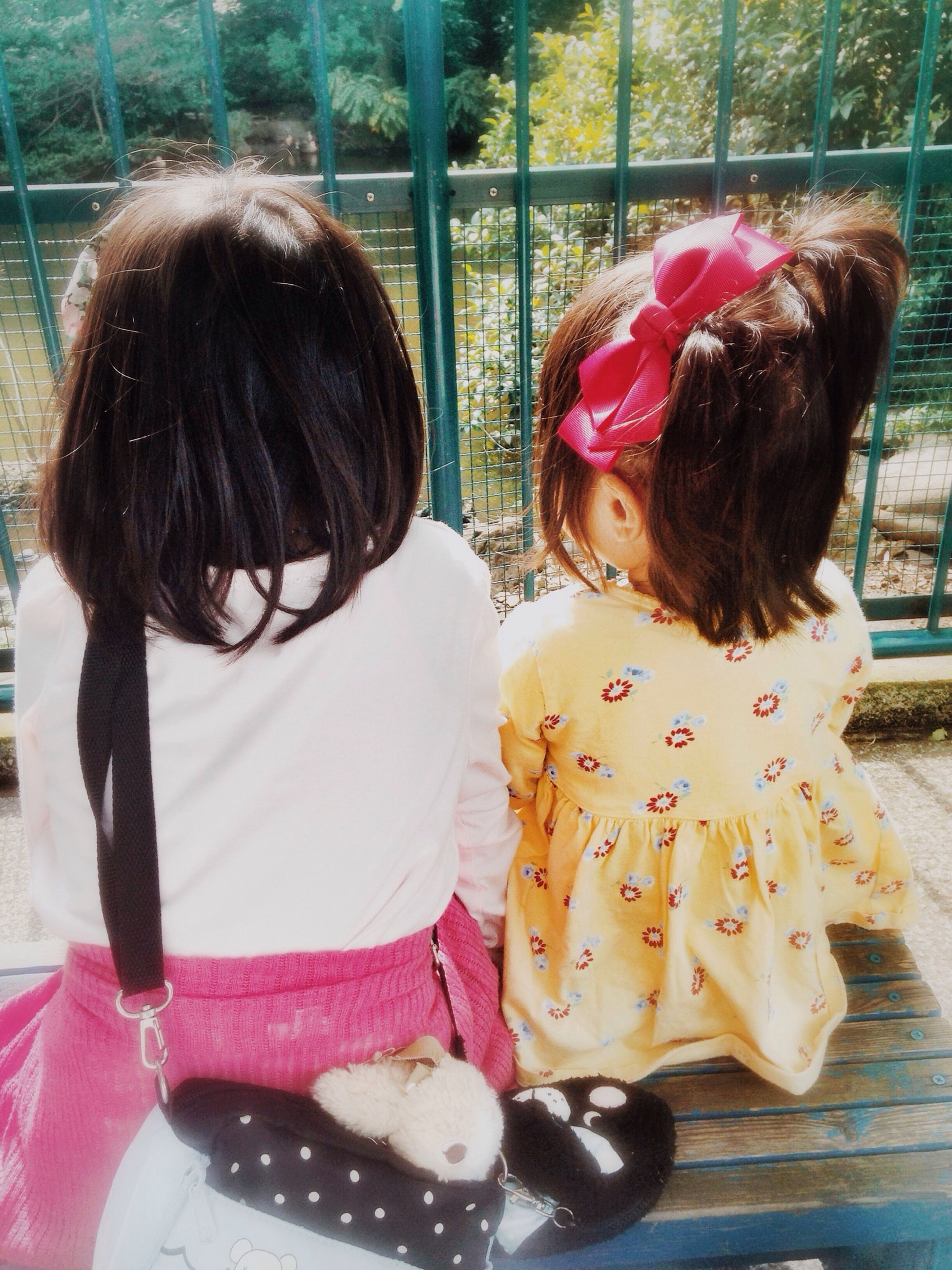 childhood, girls, elementary age, person, lifestyles, leisure activity, cute, innocence, casual clothing, boys, blond hair, togetherness, bonding, sitting, preschool age, love, long hair