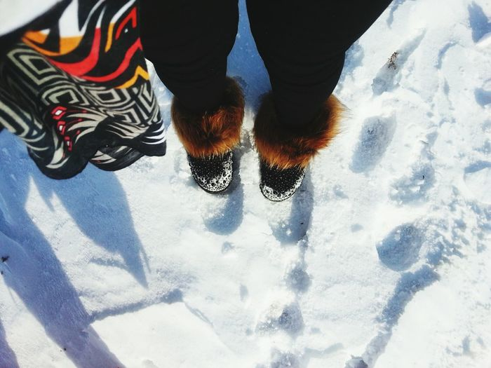 Low Section Of Person Wearing Snowshoes