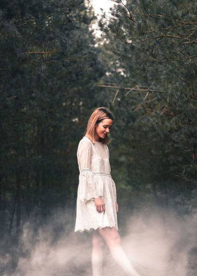 Young woman with white powder in forest