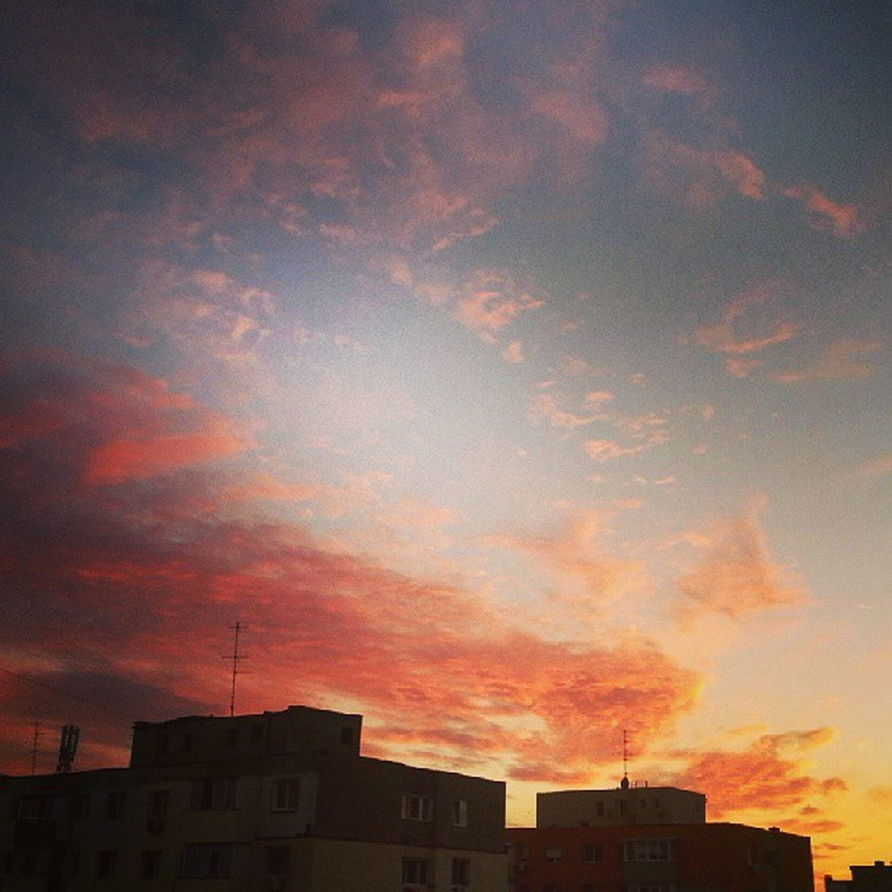 architecture, building exterior, built structure, sky, sunset, no people, cloud - sky, city, outdoors, cityscape, residential, day
