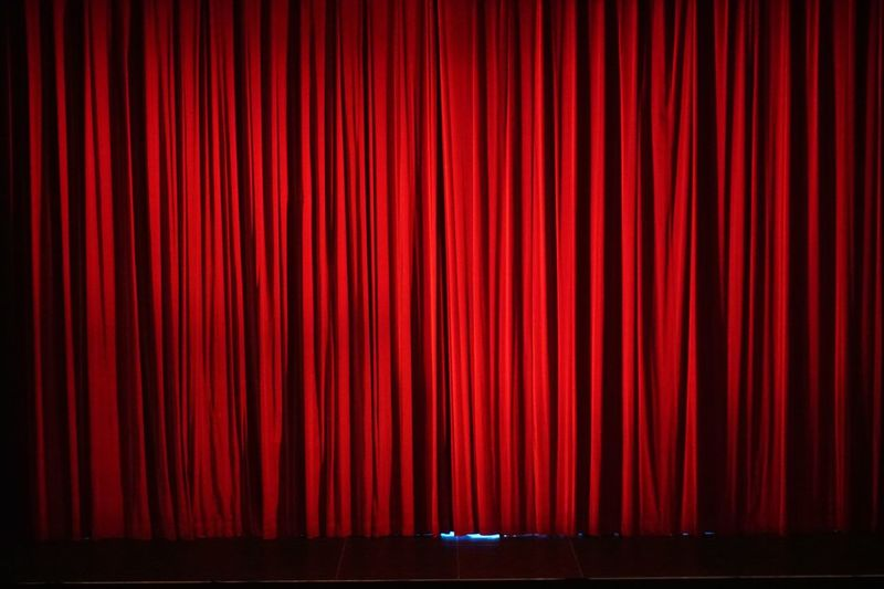 Closed Red Curtain On Stage Theater