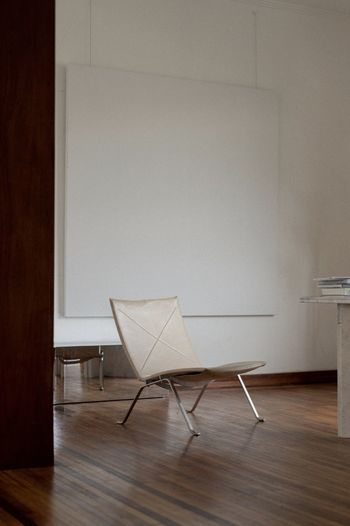 Table and chairs on floor against wall at home