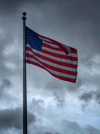 Old glory braving the storms Patriotism Flag Cloud - Sky Sky Low Angle View Pole Nature Environment No People Symbol Striped Wind National Icon Independence Outdoors Red Pride Symbolism Freedom Day