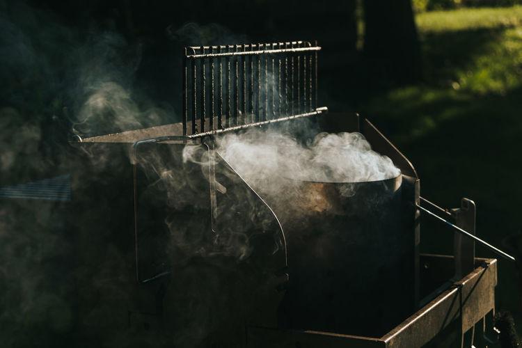 Smoke emitting from barbecue machine