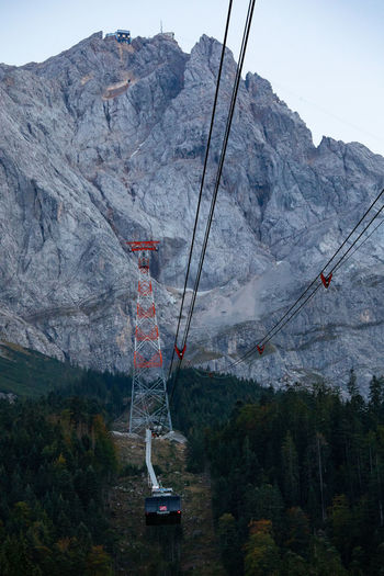 Bavaria Tadaa Community Zugspitze Beauty In Nature Cable Cable Car Day Environment Formation Mode Of Transportation Mountain Mountain Range Nature No People Non-urban Scene Outdoors Overhead Cable Car Plant Scenics - Nature Ski Lift Sky Tranquil Scene Tranquility Transportation Tree