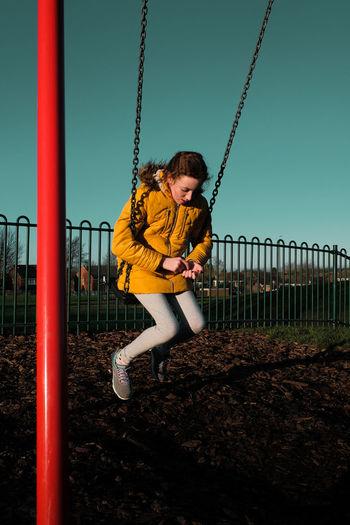Boy playing on playground