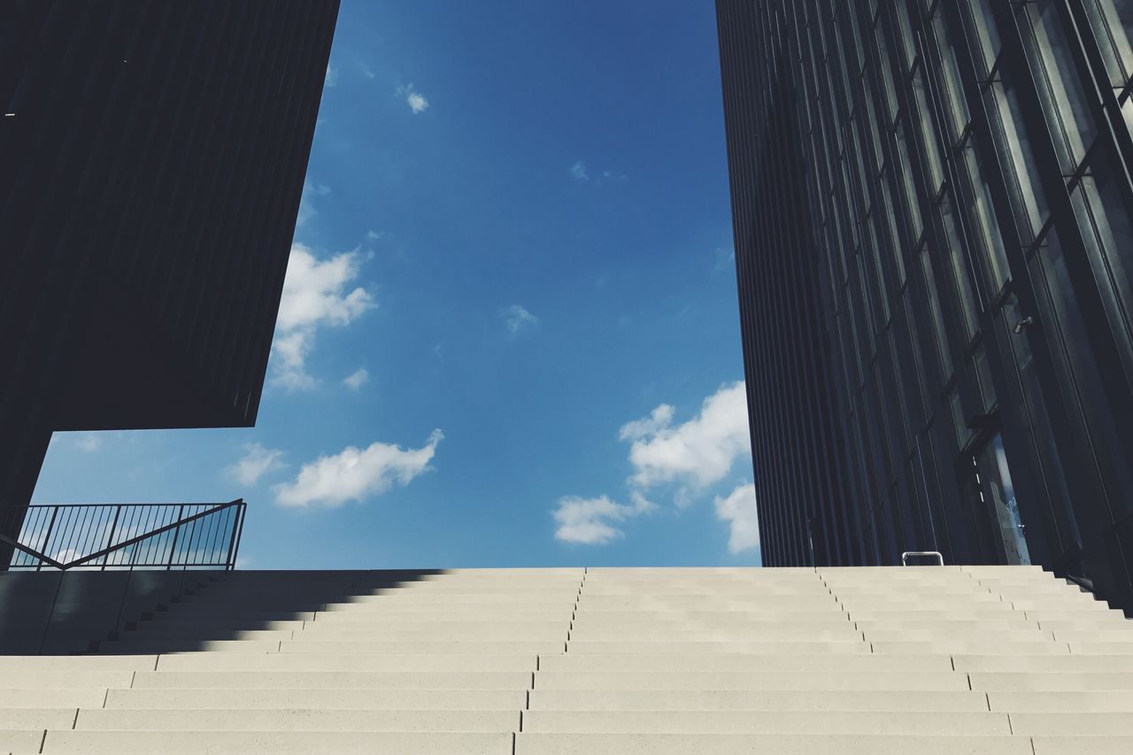 low angle view, architecture, sky, built structure, day, sunlight, no people, cloud - sky, building exterior, outdoors