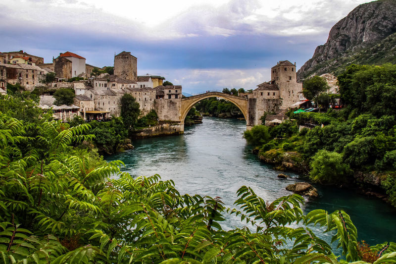 Mostar Mostar Bridge Arch Architecture Beauty In Nature Bridge - Man Made Structure Building Exterior Built Structure Cloud - Sky Day Growth History Nature Neretva No People Outdoors River Scenics Sky Travel Destinations Tree Water