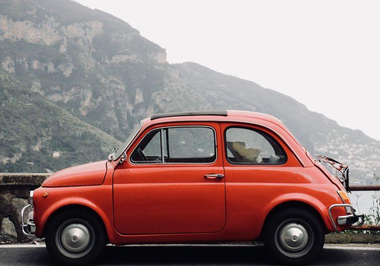 Vintage car on mountain road