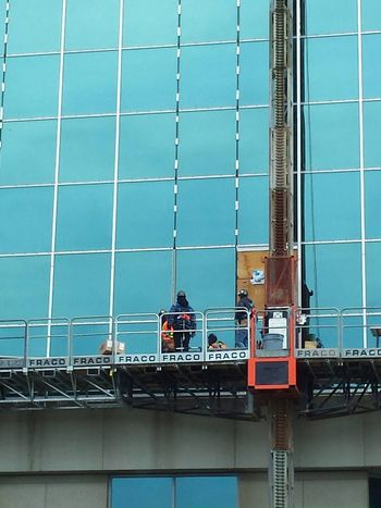 Scaffolding Structure Glass Windows People Outdoors Blue Wave High Angle View Top
