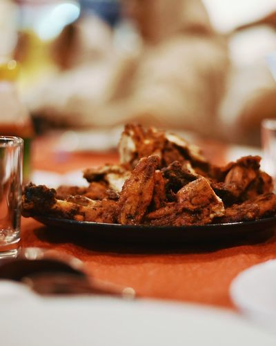 Close-up of chicken served on table