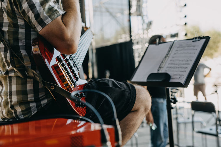 Mid section playing bass guitar