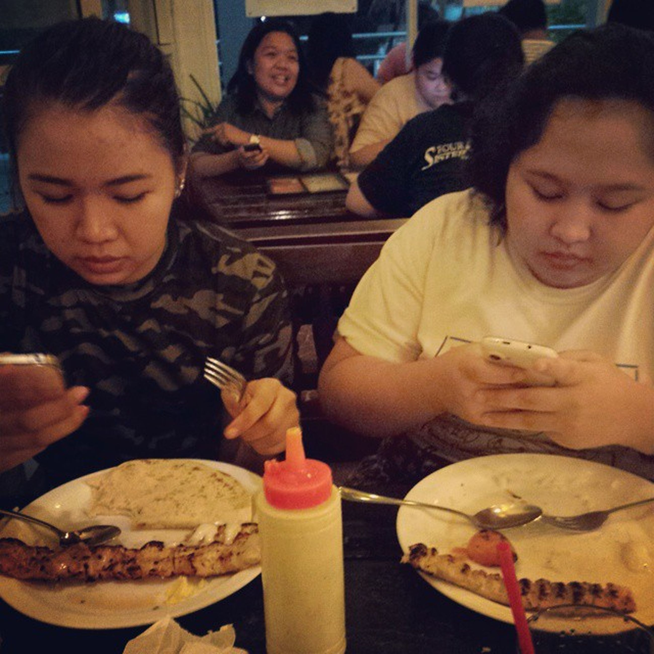 indoors, food and drink, lifestyles, togetherness, person, leisure activity, bonding, food, sitting, portrait, looking at camera, smiling, friendship, table, happiness, casual clothing, restaurant