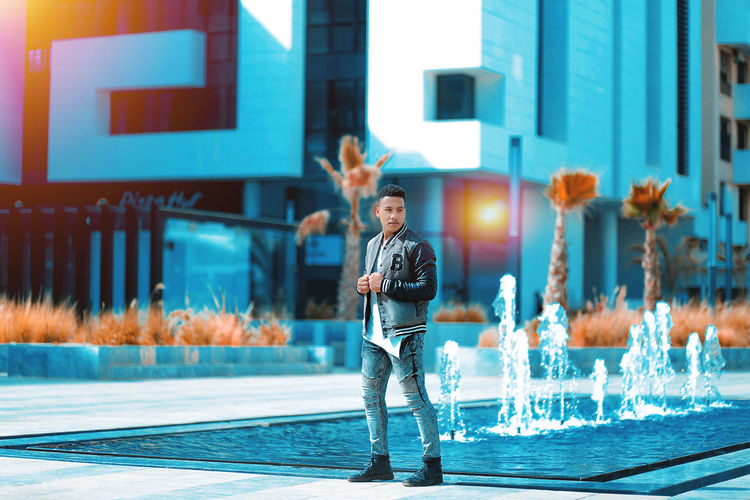 Fashion Leather Robe Adult Architecture Building Exterior Casual Clothing City Emotion Full Length Happiness Human Arm Lifestyles Man Made Object Men Model Shoot One Person Portrait Standing The Shoes Trousers Young Adult