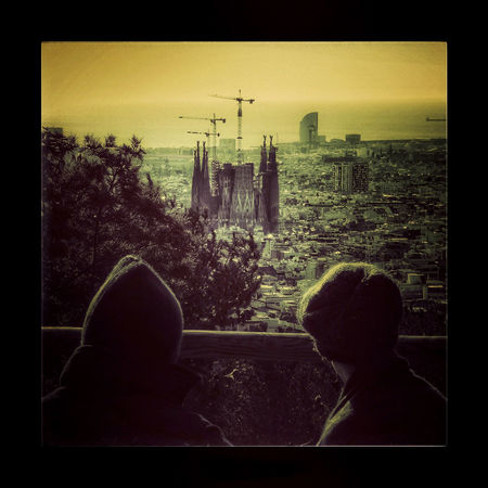 Couple Contemplating Barcelona Designed By The Architect Antoni Gaudi Temple Of The Sagrada Familia Under Construction Architecture Auto Post Production Filter Building Exterior City Cityscape Clear Sky Day Frame Landscape Nature Outdoors Real People Silhouette Sky