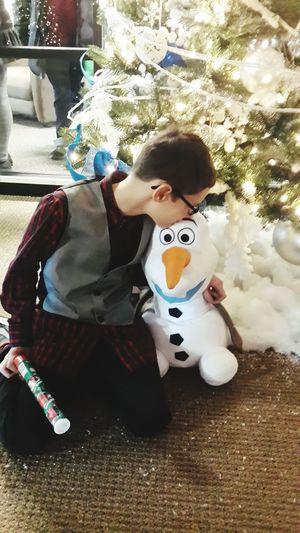 Olaf Frozen Boy Kissing Stuffed Animal Christmas Tree Christmas Around The World