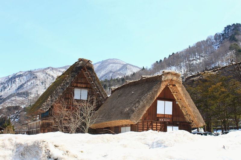 Hut on snow Shirakawago World Heritage Village Takayama Japan Scenery Outdoors Landscape Scenics - Nature Travel View Famous Place Countryside Rural Scene Mountain Range Day Country Snow Mountain Cold Temperature Winter Sky Architecture Built Structure Building Exterior