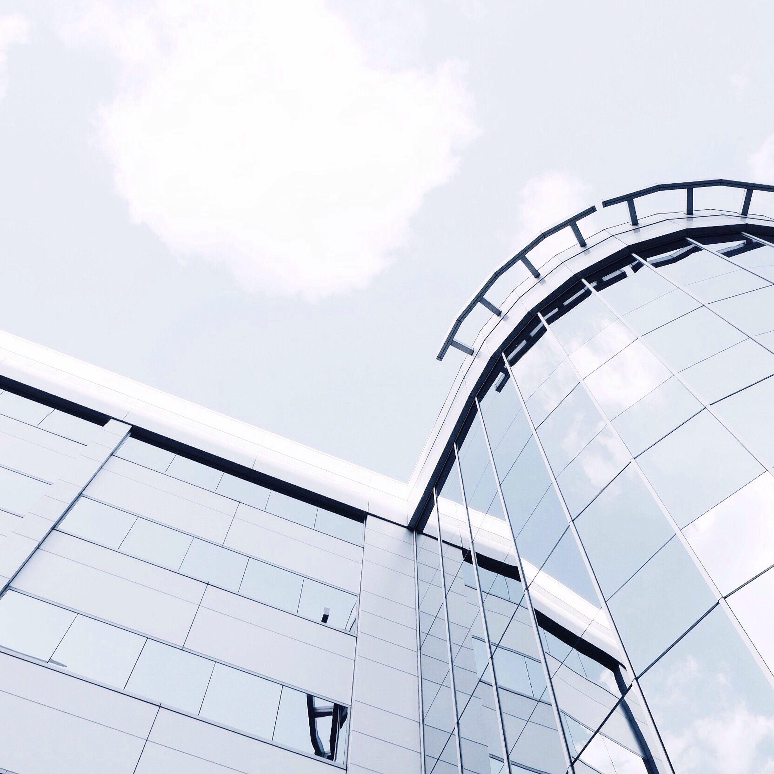 low angle view, sky, built structure, architecture, cloud - sky, amusement park, leisure activity, ferris wheel, amusement park ride, building exterior, arts culture and entertainment, cloud, day, lifestyles, modern, outdoors, cloudy, men
