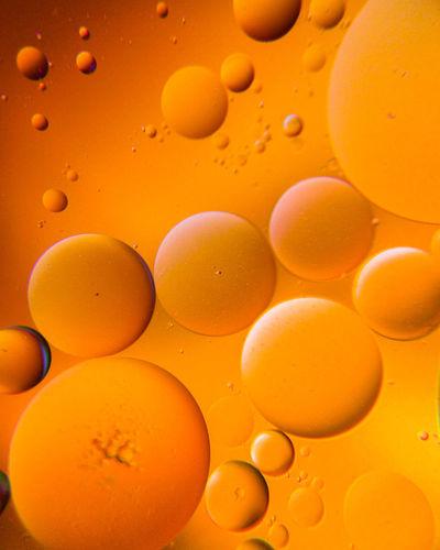 Full frame shot of water drops on orange