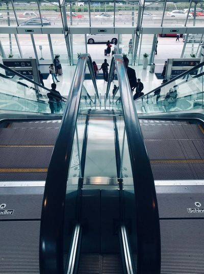 Simmetry ShotOnIphone Hong Kong Escalator Indoors  Transportation High Angle View Architecture Convenience Modern Incidental People Railing Steps And Staircases Mode Of Transportation Group Of People Staircase Built Structure Technology Metal Travel Moving Walkway  Railroad Station Ceiling