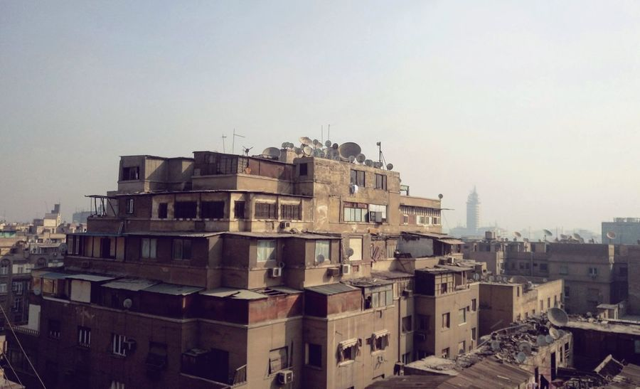 The Architect - 2017 EyeEm Awards Mobile Photography Street Photography No People Architecture Building Exterior Built Structure Residential Building City Apartment Sky Skyscraper Outdoors Cityscape Cairo Egypt Window Indoors