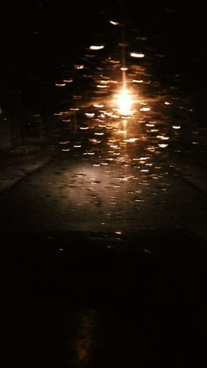 Jst a random click while driving in the rain Water Reflection Sunset Beauty In Nature Outdoors Nature Illuminated Scenics Sea No People Night Sky