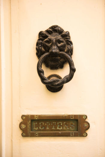 Old vintage lion head door knocker and letterbox. Valletta, Malta Bronze Entrance Iron Lion Lion Head Malta Ornament Valletta,Malta Brass Close-up Detail Door Doorway HEAD Knob Knocker Knocking Lock Mettalic No People Object Old Rusty Vintage Wooden Door