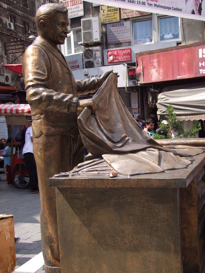 Bronze Statue of a Cloth Merchant, Grand Bazaar Art Art And Craft Bronze Statue City Cloth Merchant Composition Creativity Foreground Focus Full Frame Full Length Grand Bazaar Human Representation Incidental People Istanbul Outdoor Photography Sunlight And Shadow Symbolism Tourism Tourist Attraction  Turkey