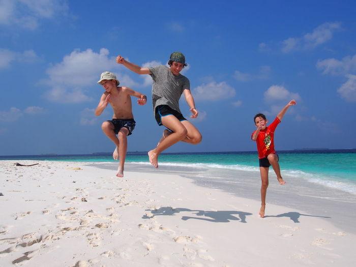 Beach Boys Child Childhood Horizon Over Water Leisure Activity Lifestyles Nature Positive Emotion Sea Sky Water