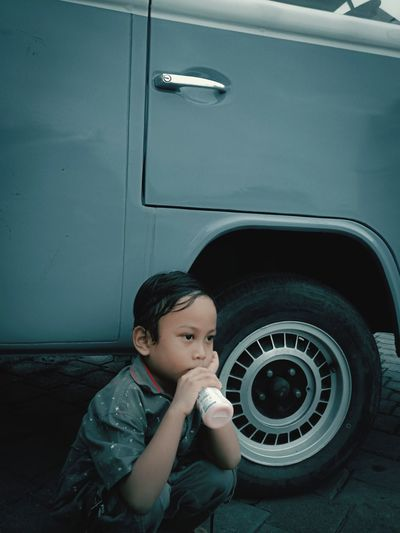 Portrait of cute boy in car