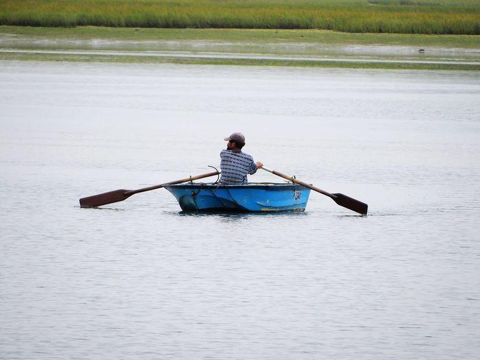Man rowing boat in lake