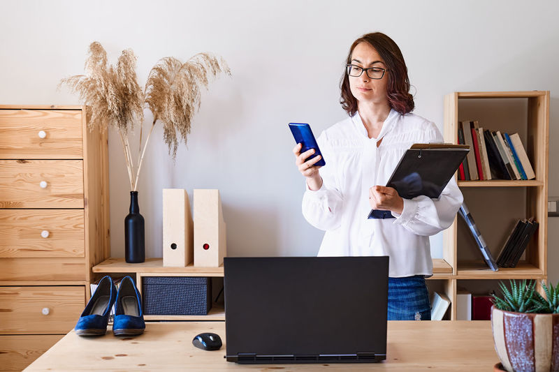 Woman using mobile phone on table