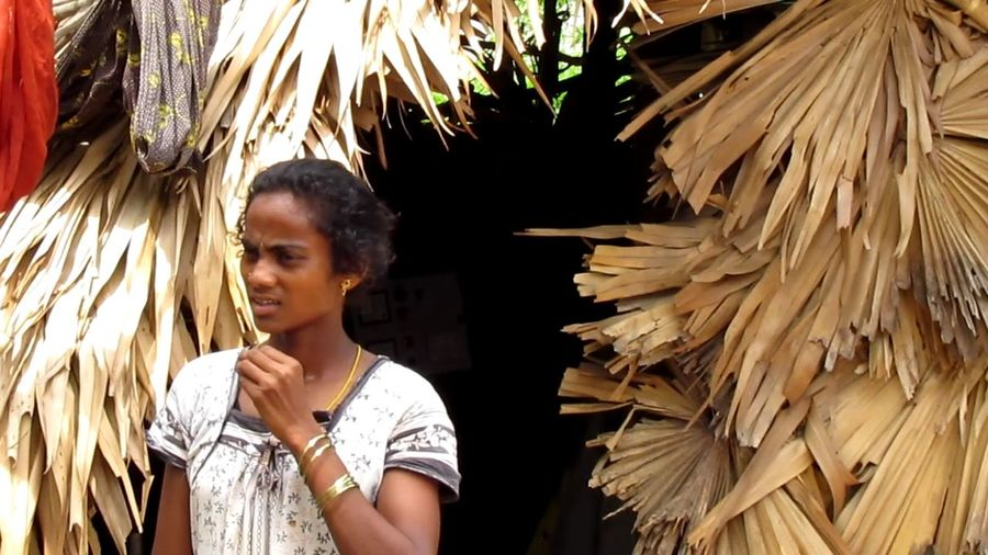 A WOMAN IN A HUT... PENURY, THY NAME IS MISERY... Poor Woman Poverty Hut Young Women Blond Hair Women Headshot Thatched Roof Shack Slum