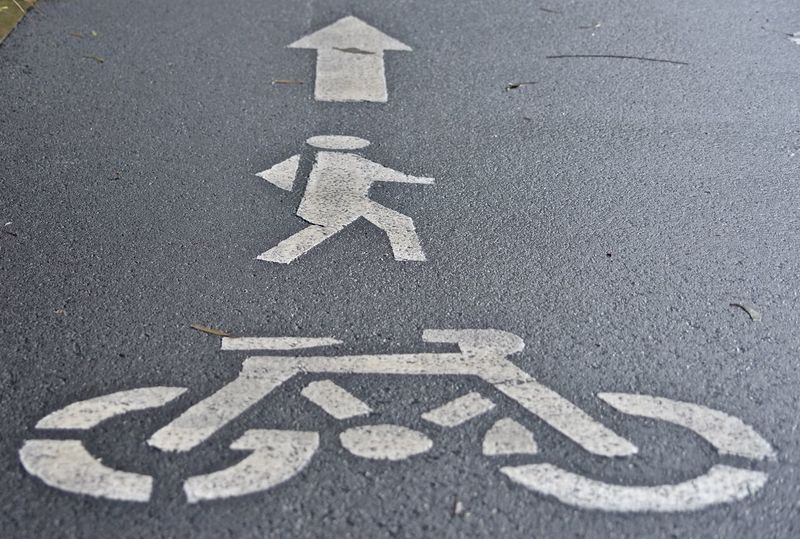Road Marking Transportation Asphalt Bicycle Lane Human Representation Guidance Road Communication High Angle View No People Day Street Road Sign Outdoors