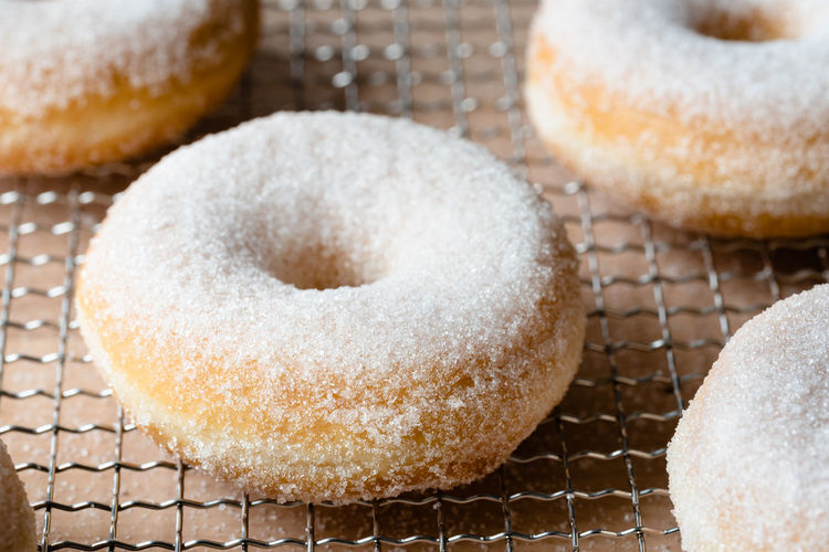donuts on cooling rack close up   daylight food photography Sweet Food Food Food And Drink Baked Sugar Donut Sweet Powdered Sugar Group Of Objects No People Cooling Rack Close-up Small Group Of Objects Ready-to-eat Food Photography Foodphotography Daylight Photography Nikonphotographer Foodporn Dessert Light And Shadow Sugar