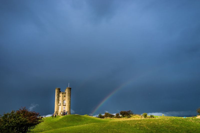 Stuff of fairytales Built Structure Architecture Storm Cloud Sky Nature Growth Outdoors Field Beauty In Nature Blue Day Multi Colored Scenics Famous Place Green Color Cloud - Sky Cloudy No People Rainbow