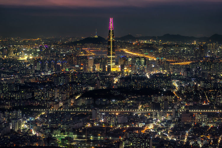 Night view over Seoul taken from Namhansanseong fortress. The view of Lotte tower lit up with the han river and namsan tower in the background Han River Korea Korean Seoul Travel Architecture Building Building Exterior Built Structure City Cityscape Crowd Crowded Illuminated Lotte Tower Nature Night Office Building Exterior Outdoors Sky Skyscraper Spire  Tall - High Tower Travel Destinations Adventures In The City