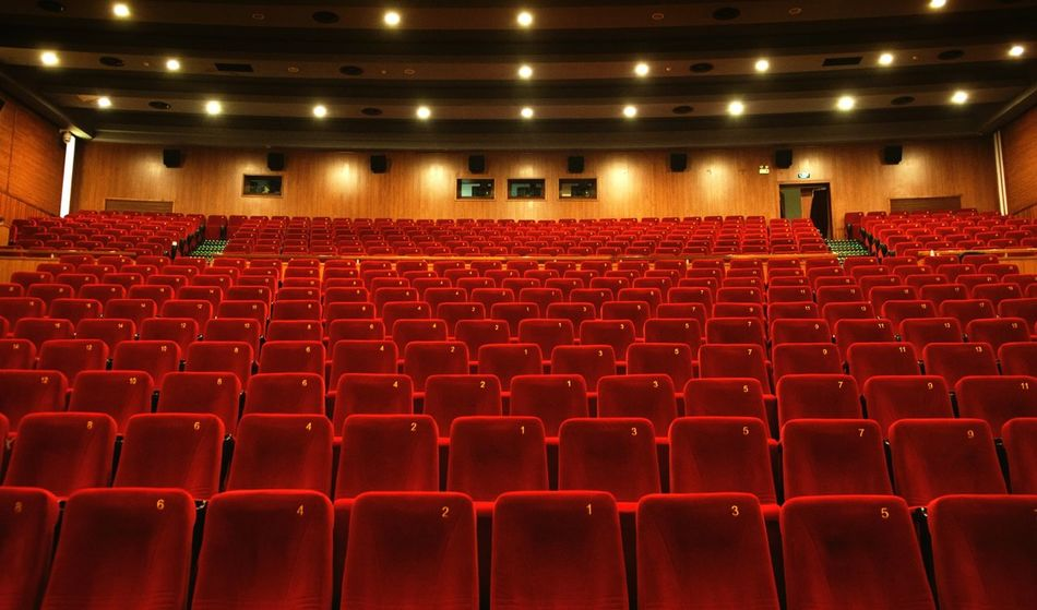 Seat Empty Indoors  Auditorium Built Structure Red Chair Movie Theater Architecture Stadium Illuminated Concert Hall  No People Film Industry City Day Cinema Movie Theatre