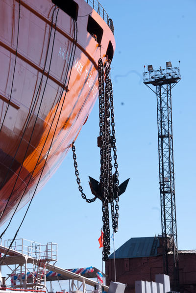 """The launch of the research vessel """"Akademik Tryoshnikov"""" at the St.Petersburg Admiralty Shipyard, March 29, 2011 Anchor Blue Hull Launch Of The Vessel Low Angle View Outdoors Shipyard Shipyard Crane Shipyardlife Sky Snow Sunny Vessel Winter"""