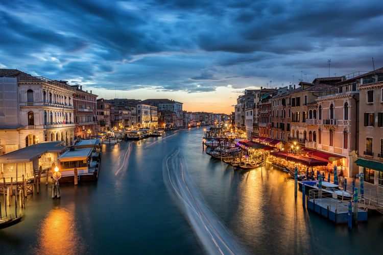 The Grande Canale in Venice, Italy, just after sunset Gondola Lights Rialto Bridge Romantic Sightseeing Storm Tourist Attraction  Travel Venezia Attraction Boats Bridge Canal Clouds Evening Illuminated Italy Long Exposure Restaurant Sunset Tourism Travel Destinations Venice Water Waterfront