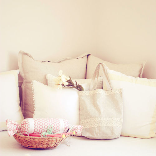Indoors  No People Pillow Furniture Container Still Life Wall - Building Feature Stuffed Domestic Room Home Interior Cushion Sofa Basket Textile White Color Close-up Table Choice Variation Large Group Of Objects Clean Interior Vintage Tote Bag Cute Feminine  Pastel