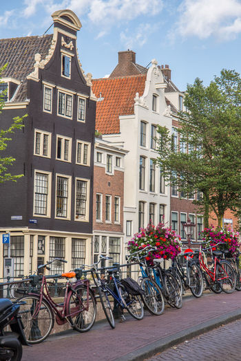 Amsterdam Netherlands Architecture Bicycle Bikes Bridge Building Building Exterior Built Structure Canal Canal House City City Life Cloud - Sky Day Dutch Houses Herengracht Holland Land Vehicle Mode Of Transportation Nature No People Outdoors Parking Residential District Row House Stationary Street Tourism Transportation Window