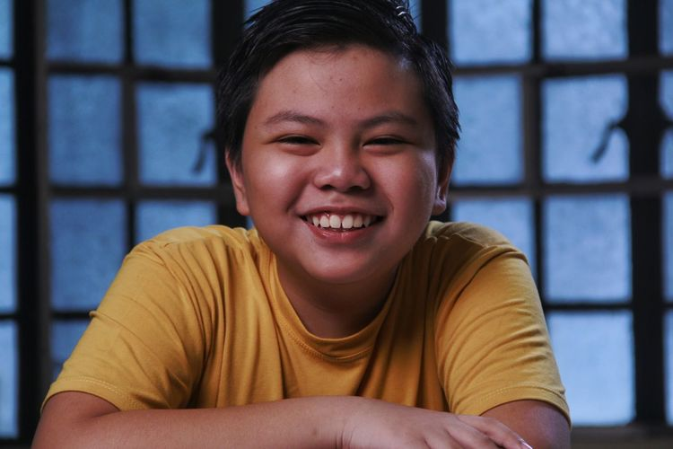 Portrait of a young asian boy smiling.