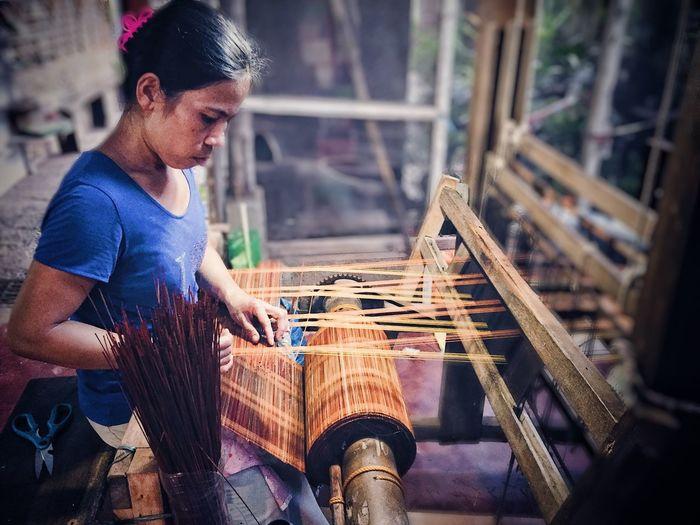 Woman weaving loom