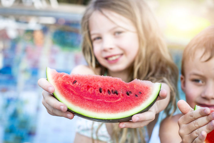 Summer vacation - children eat watermelon by the pool Holiday Hot Kids Child Childhood Females Food Food And Drink Fruit Girls Hair Happiness Headshot Healthy Eating Holding Lifestyles Offspring Pool Portrait Smiling Summer Togetherness Watermelon Wellbeing Women