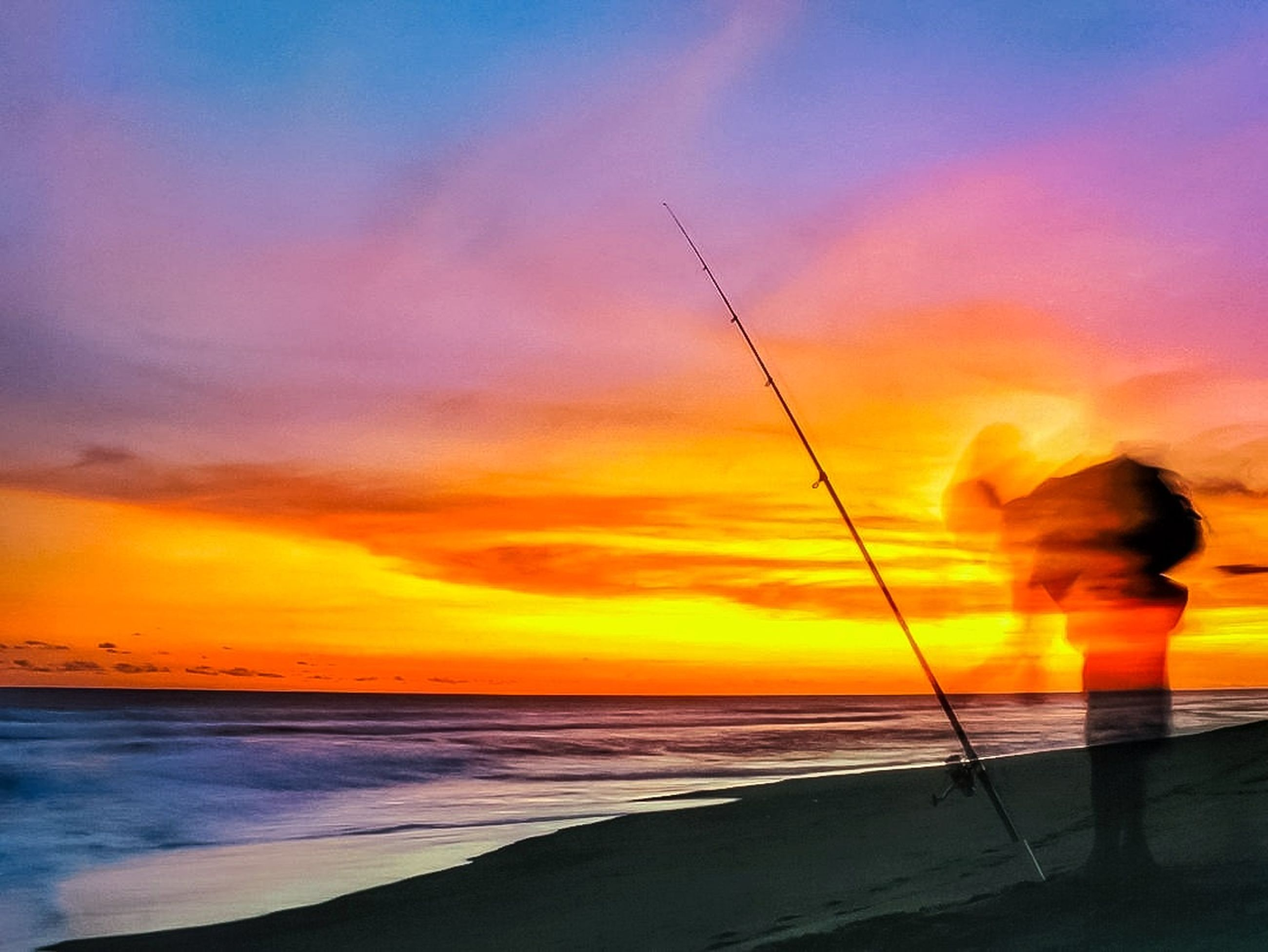 sky, sunset, water, sea, beauty in nature, cloud - sky, scenics - nature, fishing rod, beach, rod, real people, orange color, horizon over water, fishing, silhouette, horizon, land, motion, nature, outdoors