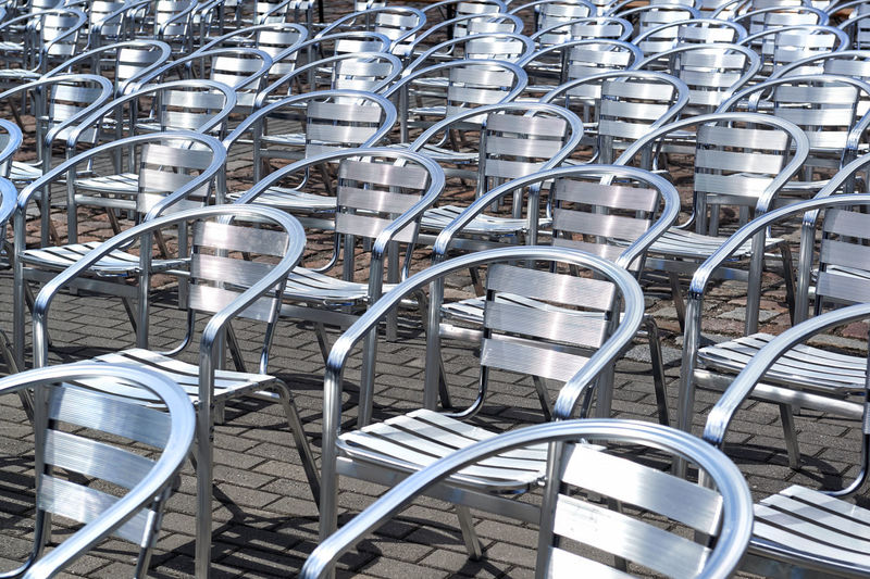 Metal chairs in a rows Chrome Chairs In A Row Iron Objects Perspective Background Chairs Chrome Chrome Chair Day Furniture Iron Chair Lot Of Chairs Many Many Chairs Metal Chair Metal Chairs Metallic No People Nobody Outdoors Pavement Row Stainless Street