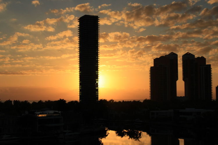 Architecture Beauty In Nature City Cloud - Sky Day Growth Nature No People Outdoors Silhouette Sky Skyscraper Sunlight Sunrise Sunrise And Clowds Water Reflections