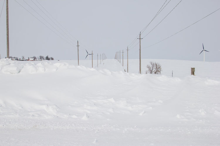 Canonphotography Canon60d Snow Winter Gravel Road Cold White Snowdrift Power Line  Minnesota Hill Windmill Wind Turbine Wind Energy Wind Power Renewable Energy Deep Sky